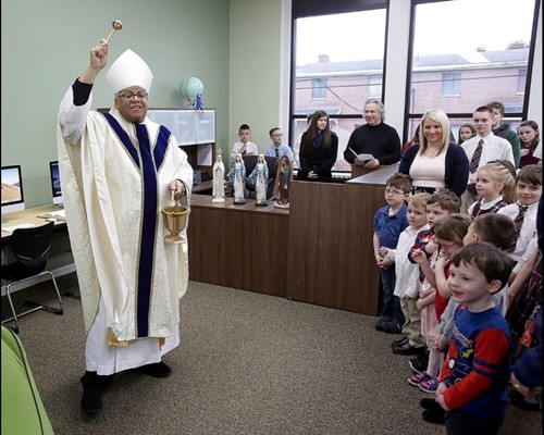 Bishop Murry blesses the new St. Barbara School library