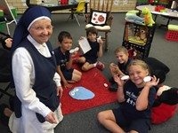 Nun with students